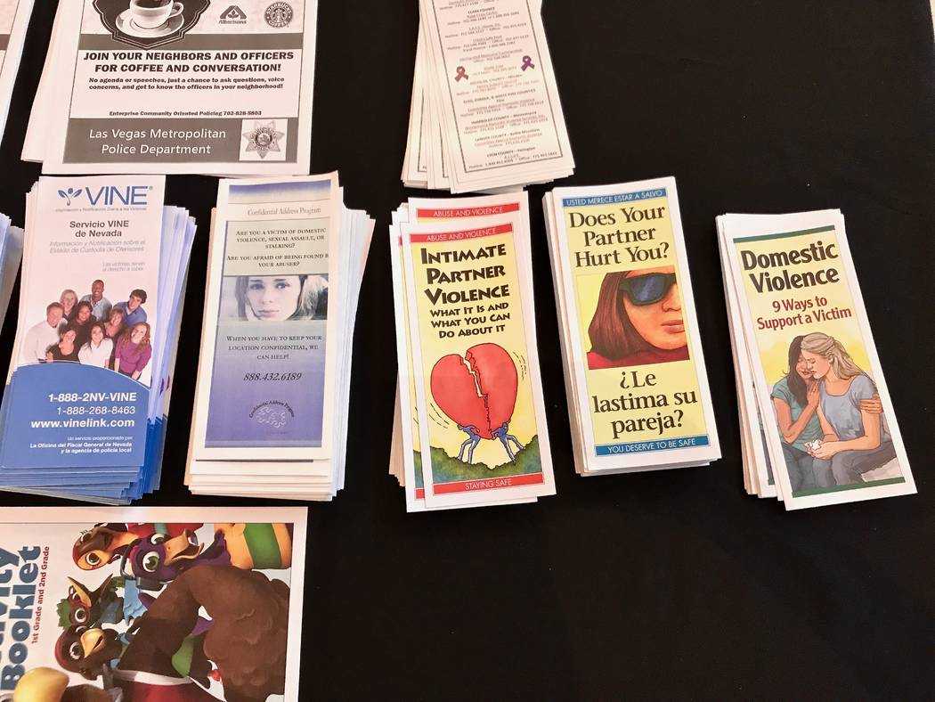 Informational pamphlets on domestic violence and human trafficking line a table outside of the Windmill Library's auditorium during the Enterprise Area Command's First Tuesday on Aug. 1. (Madelyn  ...