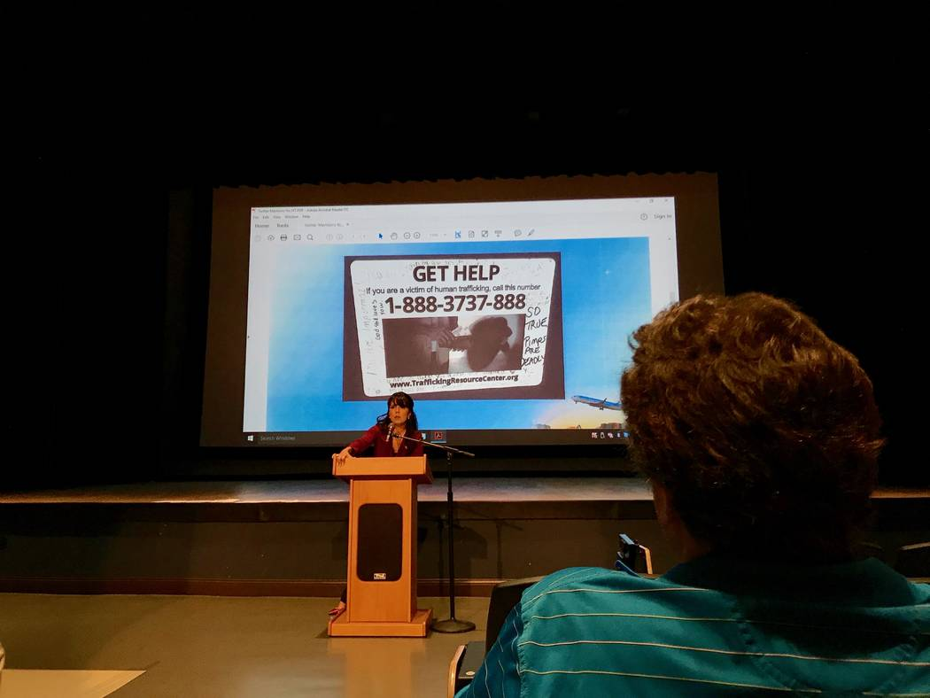 Arlene Rivera, ombudsman for the Nevada attorney general's office, addresses an audience Aug. 1, 2017, at Windmill Library for Enterprise Area Command's First Tuesday on domestic violence and huma ...