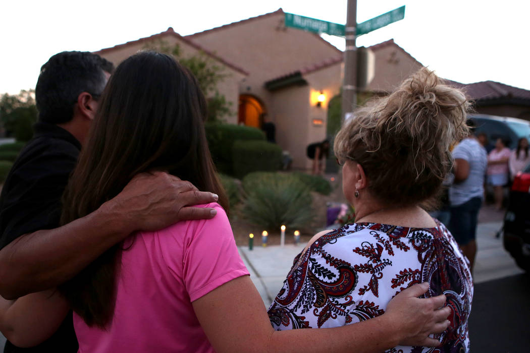 Attendees gather to mourn on the 10300 block of Numaga Road in Las Vegas, Tuesday, July 11, 2017, during a vigil for the family killed in a July 10 murder-suicide.  Nevada had the third-highest ho ...