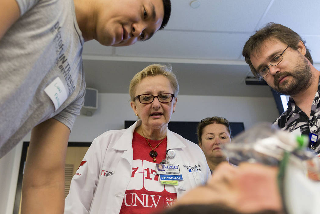 Dr. Deborah Kuhls, center, narrates an emergency medicine simulation during a UNLV graduate medical education class for resident physicians at the Clinical Simulation Center of Las Vegas office in ...