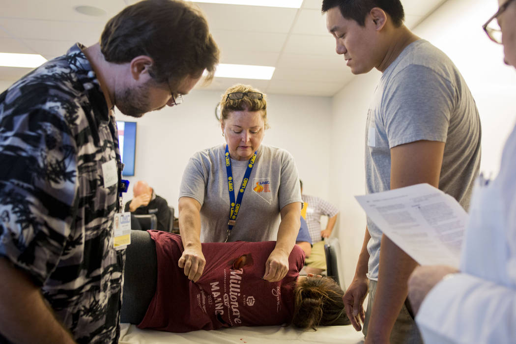 Dr. Deborah Kuhls, right, narrates an emergency medicine simulation during a UNLV graduate medical education class for resident physicians at the Clinical Simulation Center of Las Vegas office in  ...