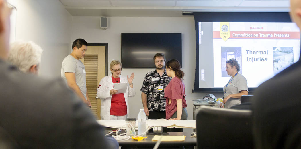 Dr. Deborah Kuhls narrates a emergency medicine simulation during a UNLV graduate medical education class for resident physicians at the Clinical Simulation Center of Las Vegas office in Las Vegas ...