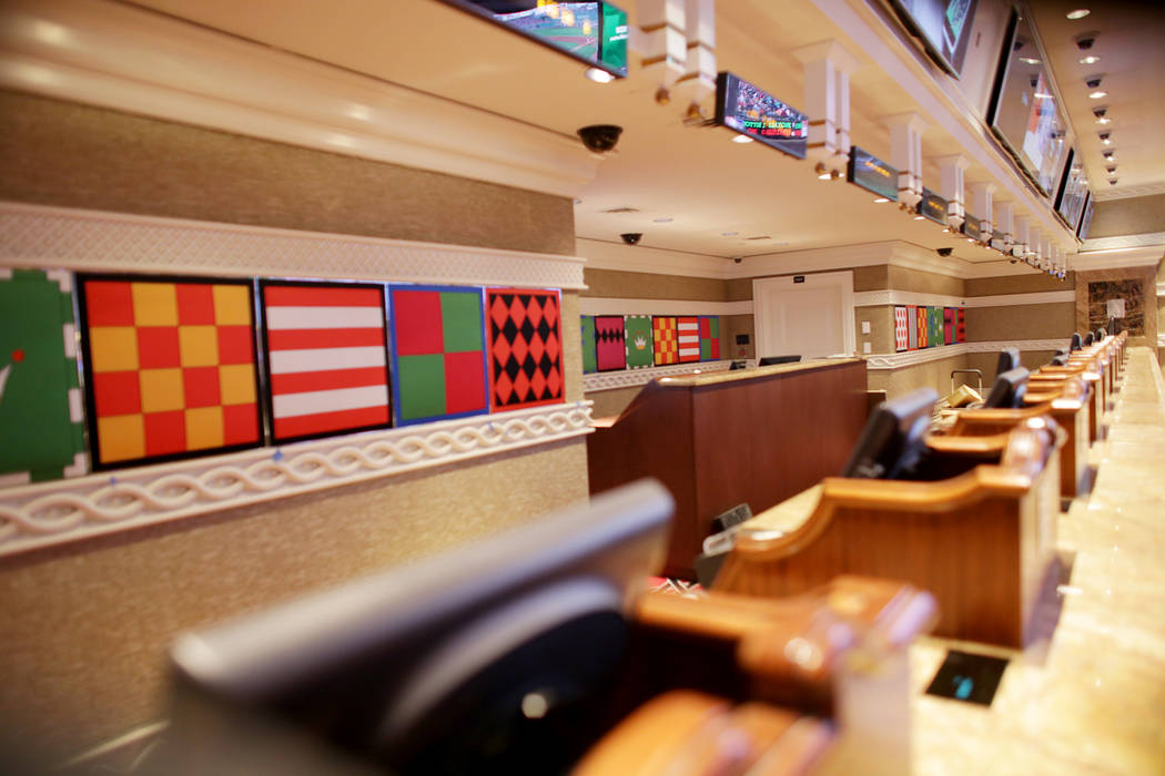 The betting desks at the new race and sports book at the Wynn on Monday, July 31, 2017, in Las Vegas. Behind the counter are new high chromatic jockey silks. There are new screens, seats and carpe ...