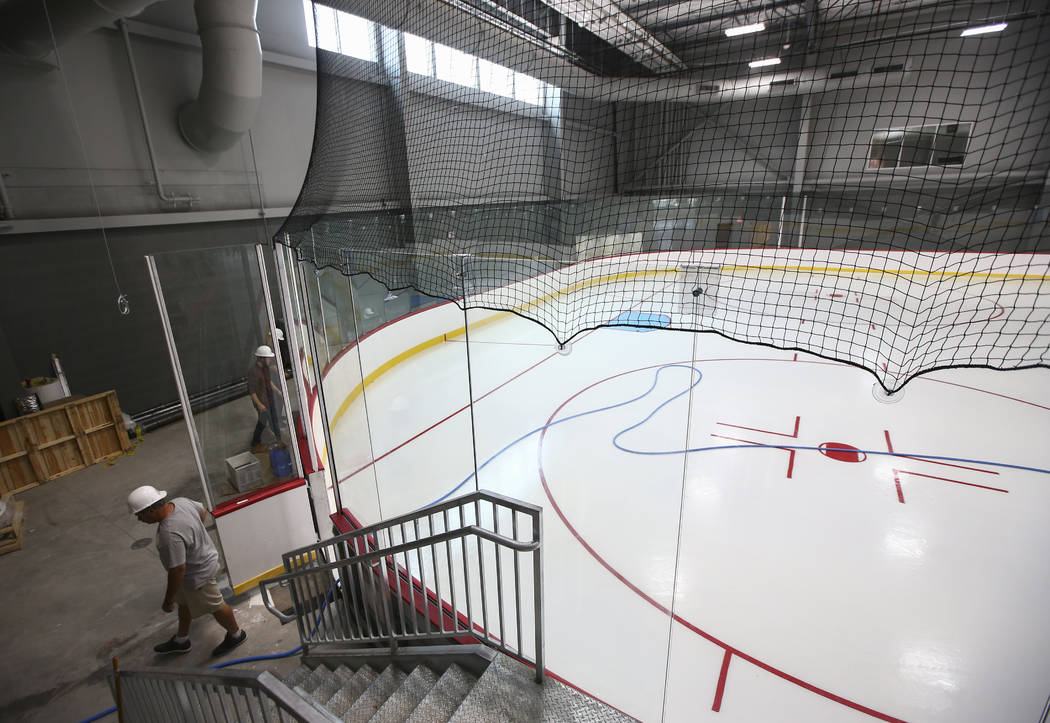 Members of the ice crew put on the finishing touches on the ice surface of one of two ice rinks at City National Arena, the Vegas Golden Knights' headquarters and training facility, in Las Vegas o ...