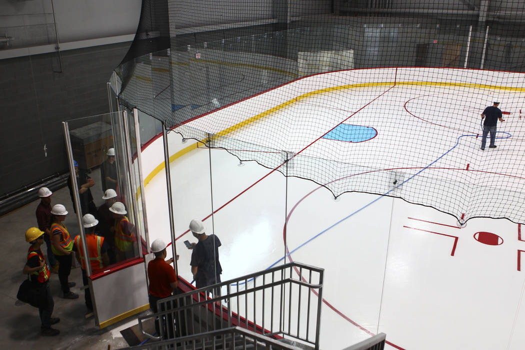 Finishing touches are applied to the ice surface of one of two ice rinks at City National Arena, the Vegas Golden Knights' headquarters and training facility, in Las Vegas on Wednesday, Aug. 2, 20 ...