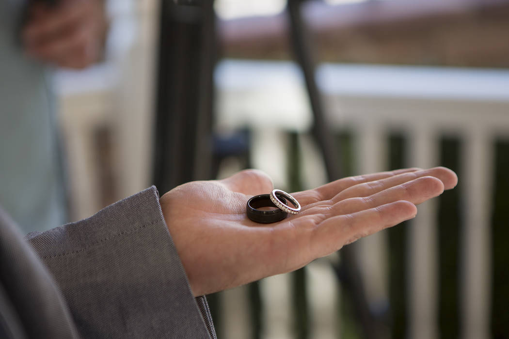 Rings are presented during Rebecca Poncsak and Scott Deutscher's wedding ceremony at Vegas Weddings in Las Vegas on Saturday, Aug. 12, 2017. Bridget Bennett Las Vegas Review-Journal @bridgetkbennett