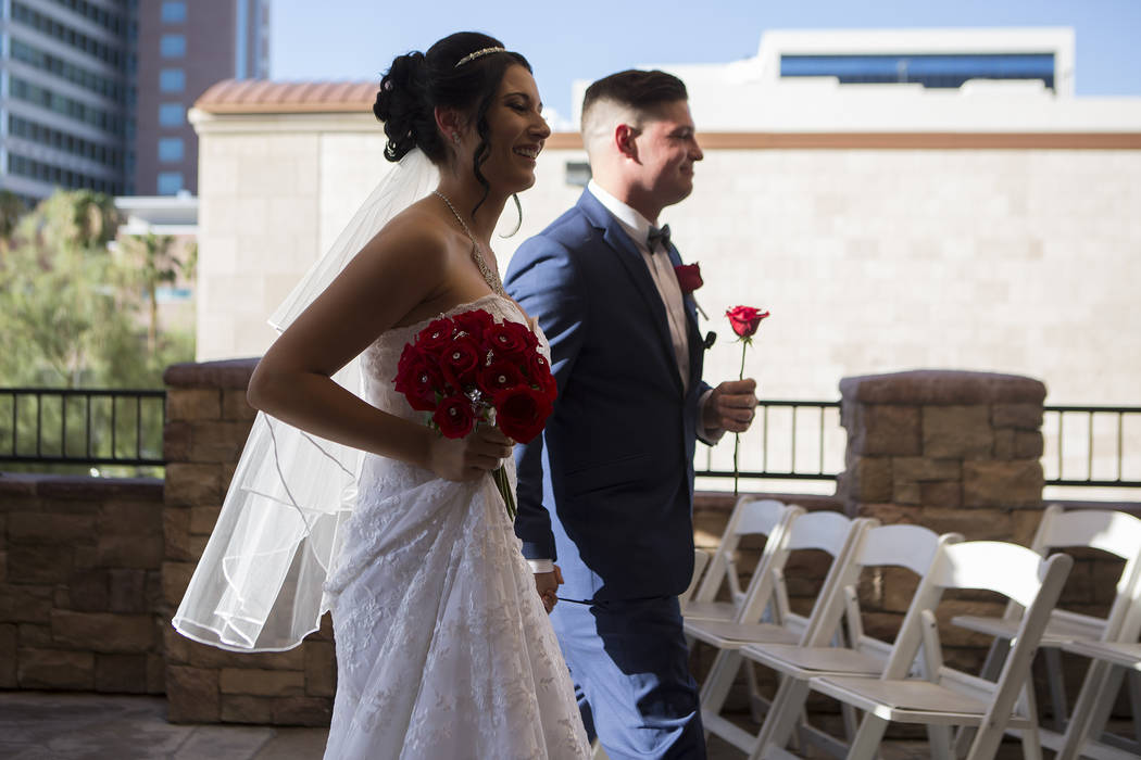 Newlyweds Rebecca Poncsak and Scott Deutscher walk down the isle after their wedding ceremony at Vegas Weddings in Las Vegas on Saturday, Aug. 12, 2017. Bridget Bennett Las Vegas Review-Journal @b ...