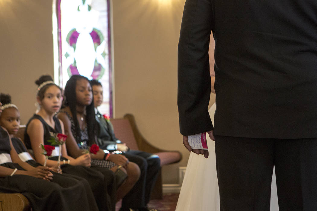 Aubrey Robinson holds a note in his hand prior renewing his vows with wife Patricia Robinson at Vegas Weddings in Las Vegas on Saturday, Aug. 12, 2017. Bridget Bennett Las Vegas Review-Journal @br ...