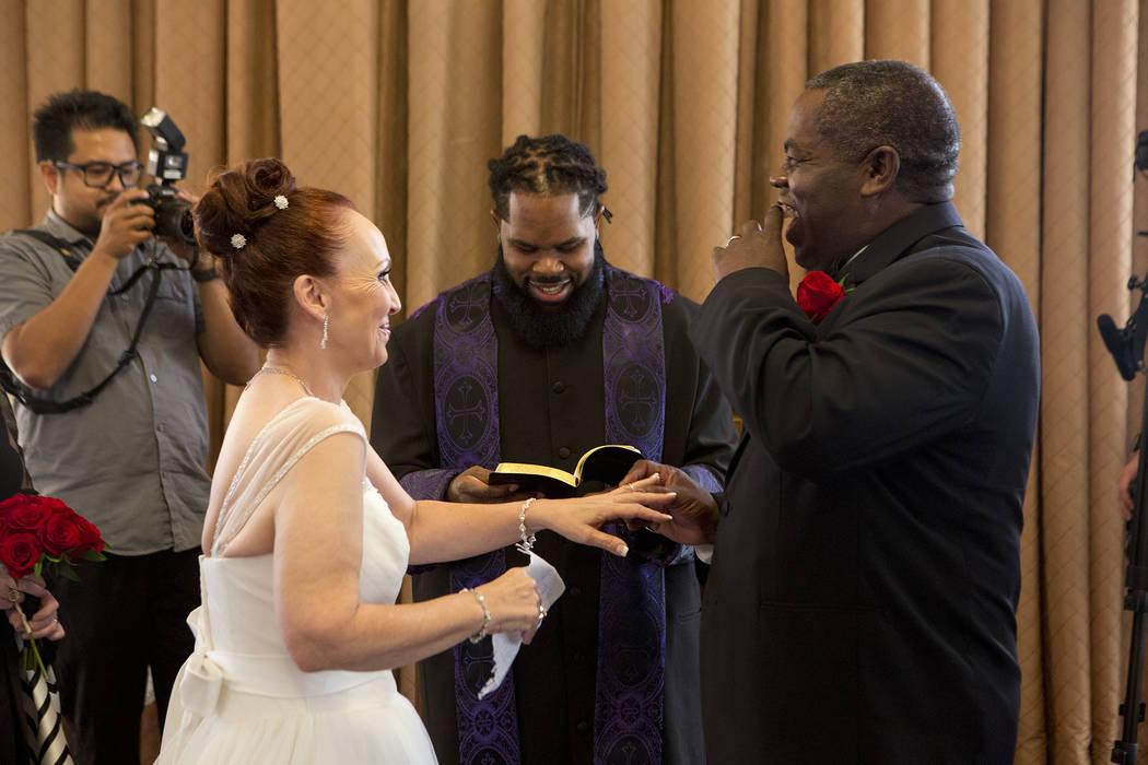 Patricia Robinson, left, and Aubrey Robinson renew their vows at Vegas Weddings in Las Vegas on Saturday, Aug. 12, 2017. Bridget Bennett Las Vegas Review-Journal @bridgetkbennett