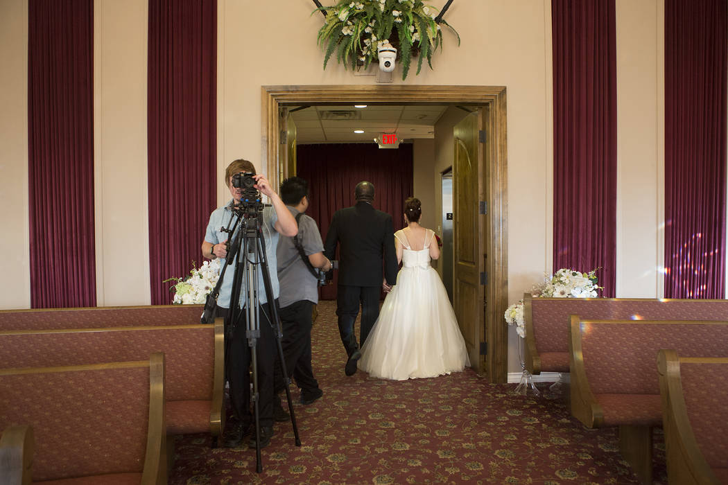 Aubrey Robinson, left, and Patricia Robinson walk down the isle after renewing their vows at Vegas Weddings in Las Vegas on Saturday, Aug. 12, 2017. Bridget Bennett Las Vegas Review-Journal @bridg ...
