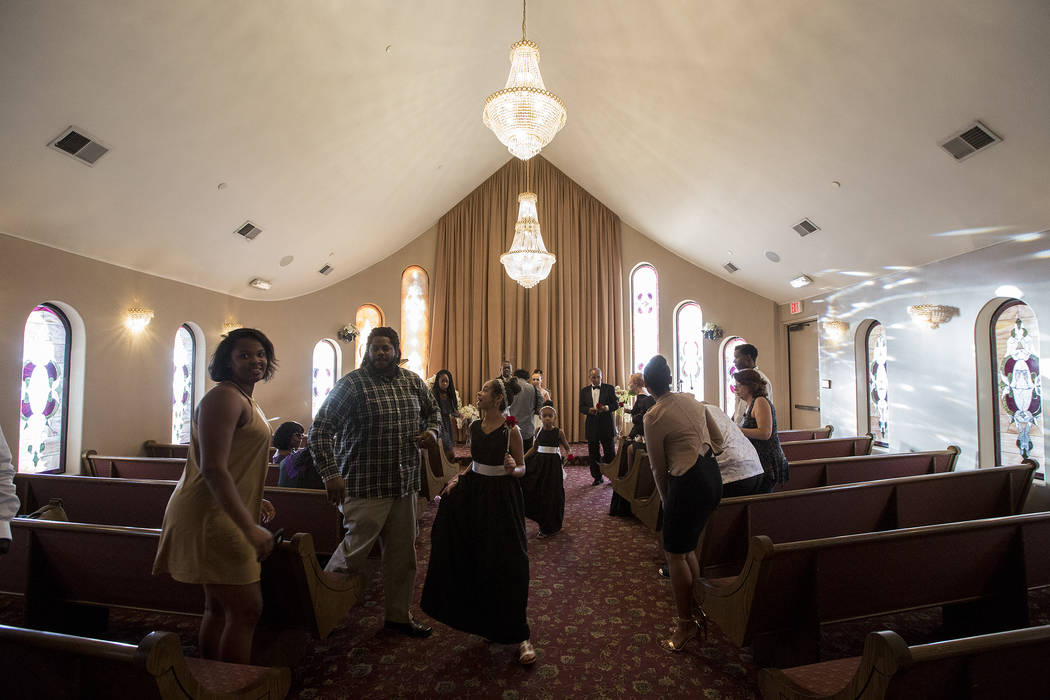 Family and friends of Patricia Robinson and Aubrey Robinson clear the chapel after they renewed their vows at Vegas Weddings in Las Vegas on Saturday, Aug. 12, 2017. Bridget Bennett Las Vegas Revi ...