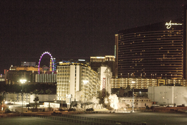 The Clarion is imploded early Tuesday, Feb. 10, 2015. The hotel was formerly known as the Royal Americana, Paddlewheel, Debbie Reynolds Hollywood Hotel and Greek Isles. (Jeff Scheid/Las Vegas Revi ...