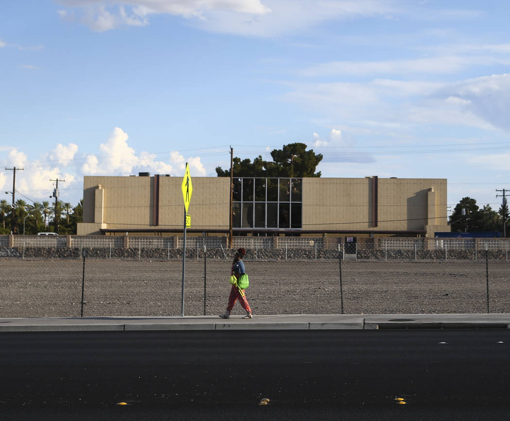 A woman walks by the lot where The Clarion Hotel and Casino once stood on Convention Center Drive in Las Vegas on Wednesday, Aug. 2, 2017. Chase Stevens Las Vegas Review-Journal @csstevensphoto