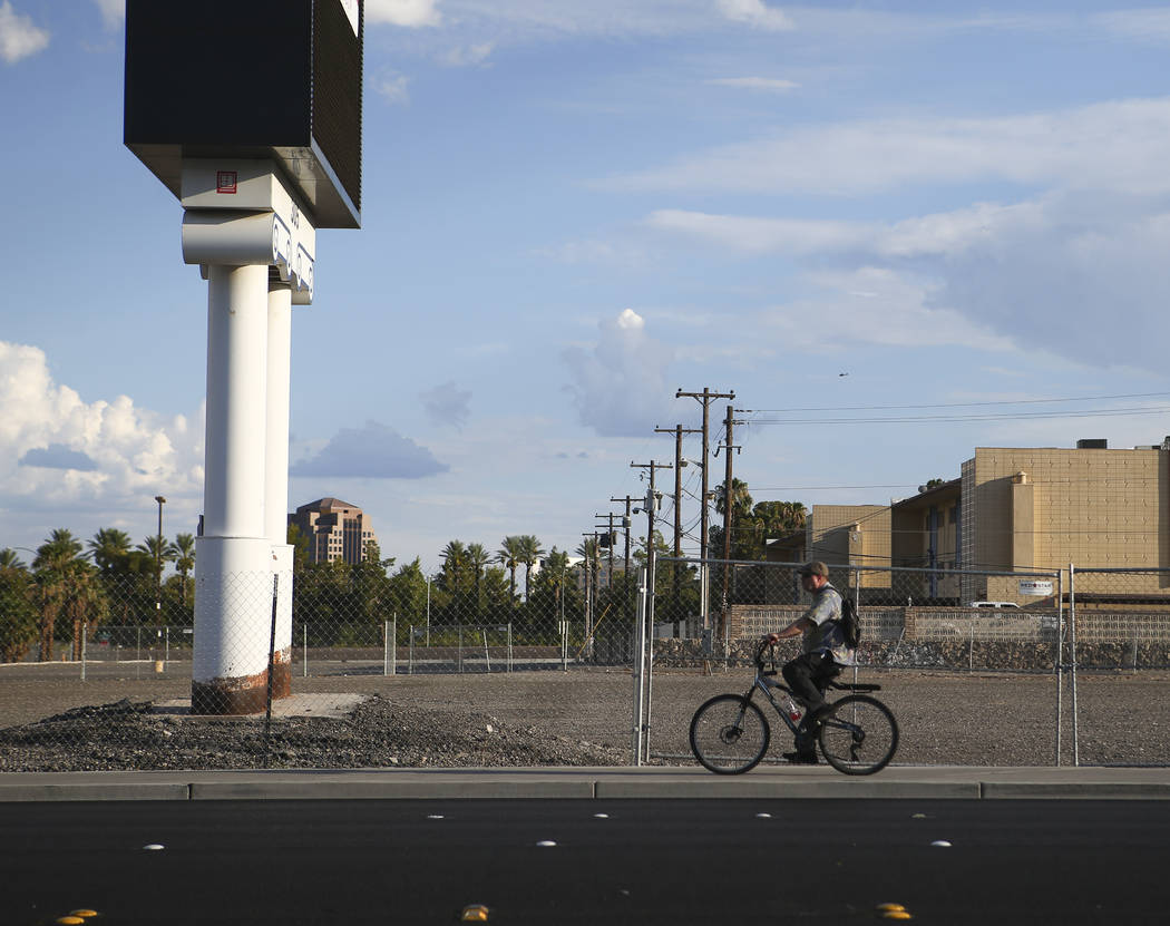 A cyclist passes by the lot where The Clarion Hotel and Casino once stood on Convention Center Drive in Las Vegas on Wednesday, Aug. 2, 2017. Chase Stevens Las Vegas Review-Journal @csstevensphoto