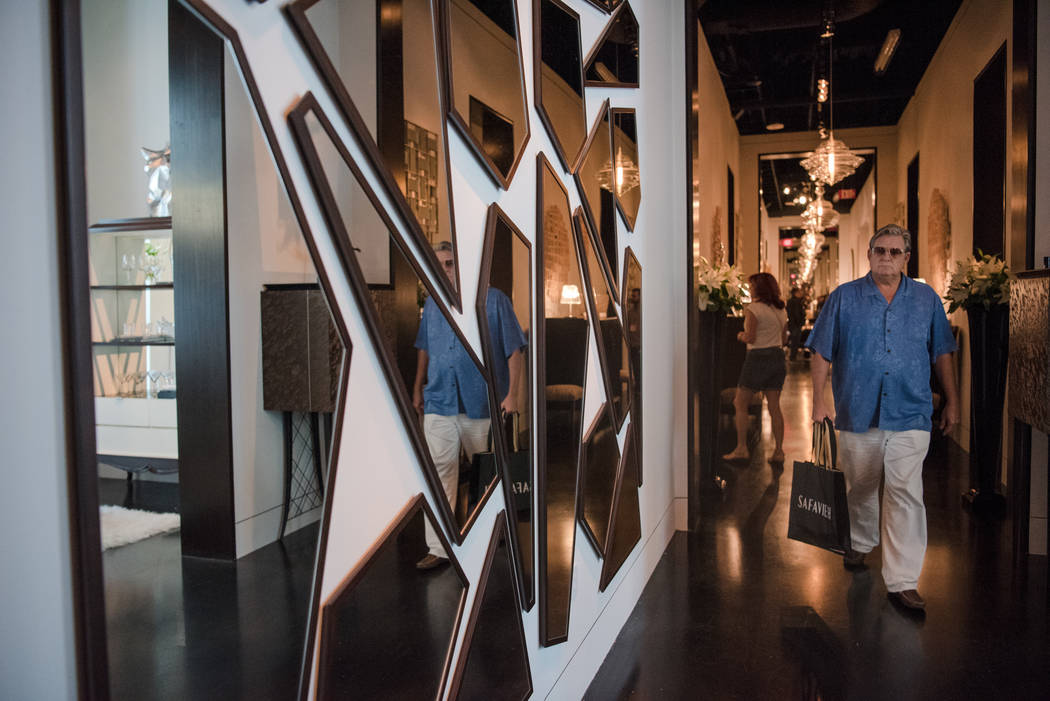 Florida resident Don Tessmer walks through an exhibitor space at Las Vegas Market at World Market Center on Tuesday, August 1, 2017, in Las Vegas. Morgan Lieberman Las Vegas Review-Journal