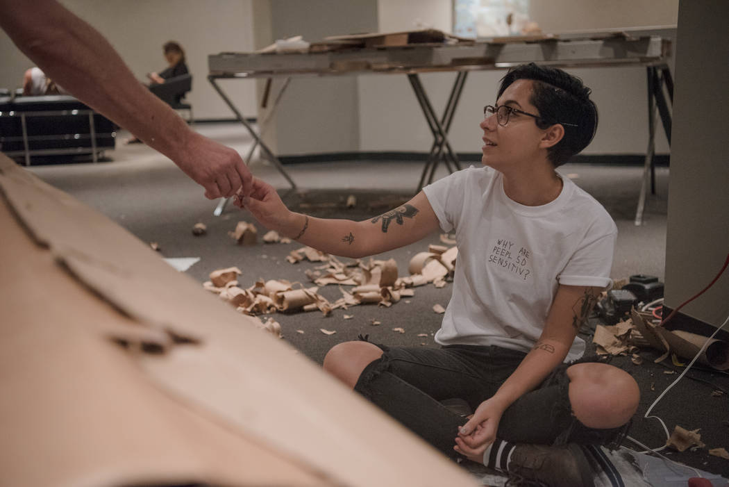 Mary Sabo, right, works on a sustainable art piece with Christopher Jones at Las Vegas Market at World Market Center on Tuesday, August 1, 2017, in Las Vegas. Morgan Lieberman Las Vegas Review-Journal