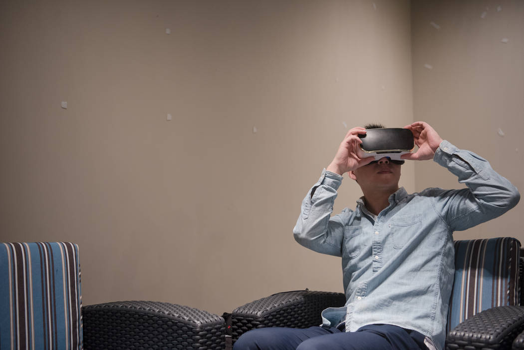 Yunjiang Sheng looks through his virtual reality headset at footage of a furniture factory in China at Las Vegas Market at World Market Center on Tuesday, August 1, 2017, in Las Vegas. Morgan Lieb ...