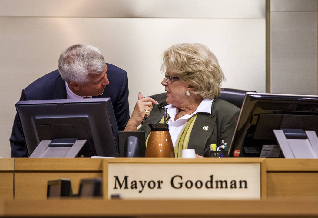 Councilman Steve Seroka talks with Mayor Carolyn Goodman during public comment about the Badlands golf course development at a City Council meeting at Las Vegas City Hall on Wednesday, August 2, 2 ...