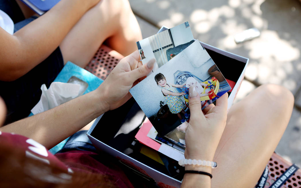 Allison Rogers, cousin of Haylei Hughes, who died in hiking accident July 26 in Washington state, shows photos of Hughes at age three, during an interview at Trails Park in Las Vegas, Tuesday, Aug ...