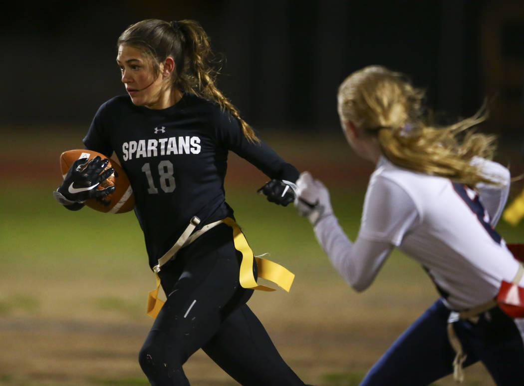 Cimarron-Memorial's Haylei Hughes (18) runs the ball against Coronado during the Class 4A state championship flag football game at Cimarron-Memorial High School in Henderson on Wednesday, Feb. 22, ...