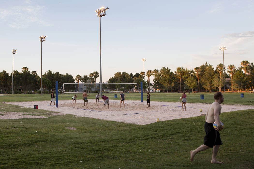 Visitors play volleyball as the sun sets at Sunset Park in Las Vegas on Tuesday, Aug. 1, 2017. Bridget Bennett Las Vegas Review-Journal @bridgetkbennett