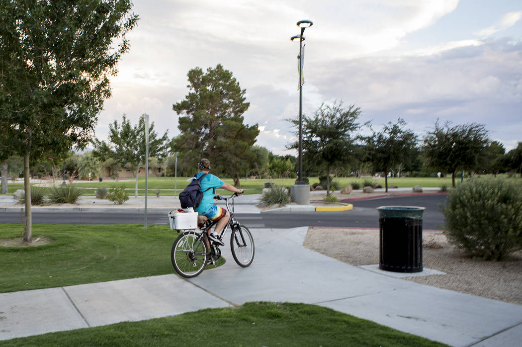 A woman bikes through Sunset Park in Las Vegas on Tuesday, Aug. 1, 2017. Bridget Bennett Las Vegas Review-Journal @bridgetkbennett