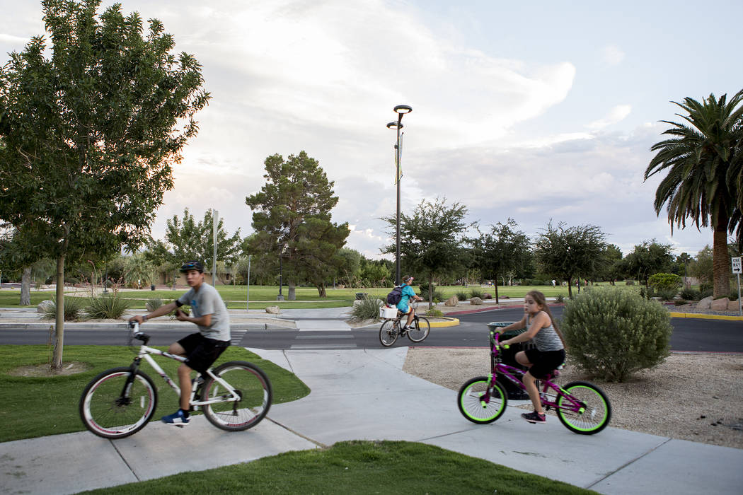 Visitors bike through Sunset Park in Las Vegas on Tuesday, Aug. 1, 2017. Bridget Bennett Las Vegas Review-Journal @bridgetkbennett