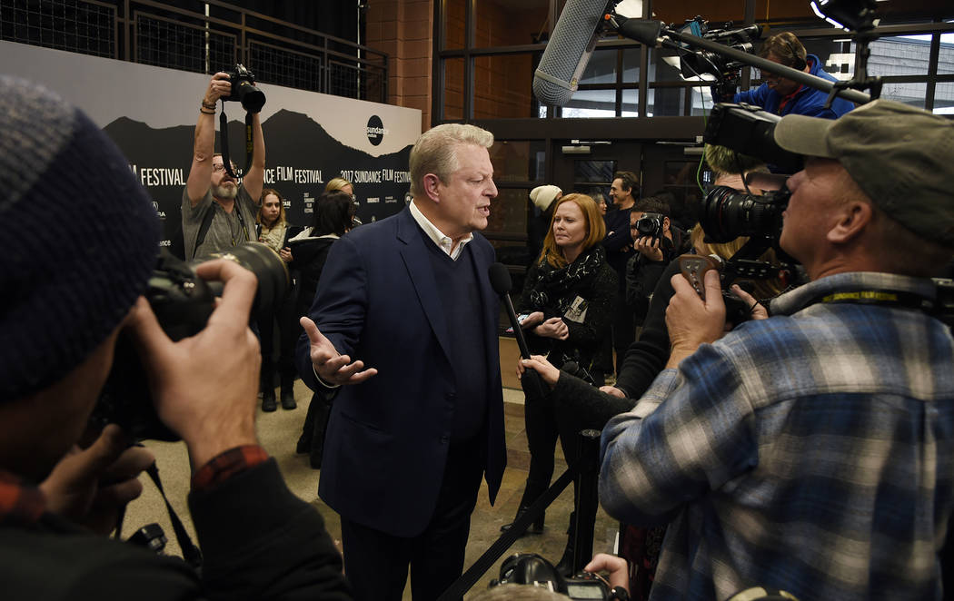 "Former U.S. Vice President Al Gore, center, is surrounded by media at the premiere of the film ""An Inconvenient Sequel: Truth to Power,"" at the Eccles Theater during the 2017 Sun ..."
