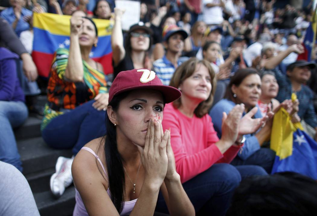 An anti-government demonstrator attends a vigil in honor of those who have been killed during clashes between security forces and demonstrators in Caracas, Venezuela, Monday, July 31, 2017. Many a ...