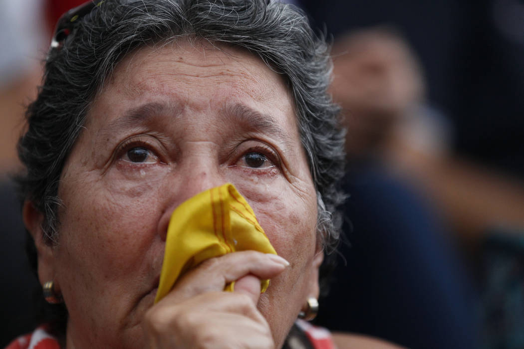 An anti-government demonstrator cries during a vigil in honor of those who have been killed during clashes between security forces and demonstrators in Caracas, Venezuela, Monday, July 31, 2017. M ...