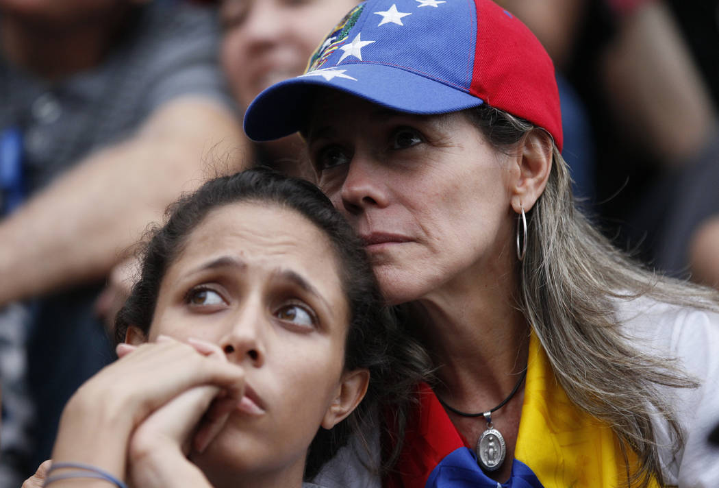 Anti-government demonstrators attend a vigil in honor of those who have been killed during clashes between security forces and demonstrators in Caracas, Venezuela, Monday, July 31, 2017. Many anal ...