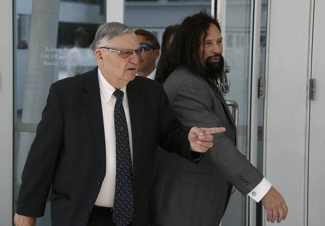 Former Maricopa County Sheriff Joe Arpaio, left, leaves U.S. District Court on the first day of his contempt-of-court trial June 26, 2017, with attorney Mark Goldman, right, in Phoenix. (Ross D. F ...