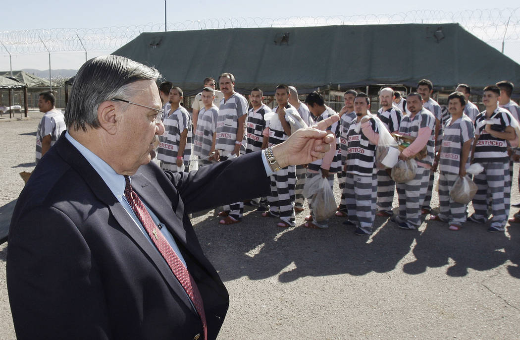 Maricopa County Sheriff Joe Arpaio, left, orders approximately 200 convicted illegal immigrants handcuffed together Feb. 4, 2009, in Tent City in Phoenix for incarceration until their sentences ar ...