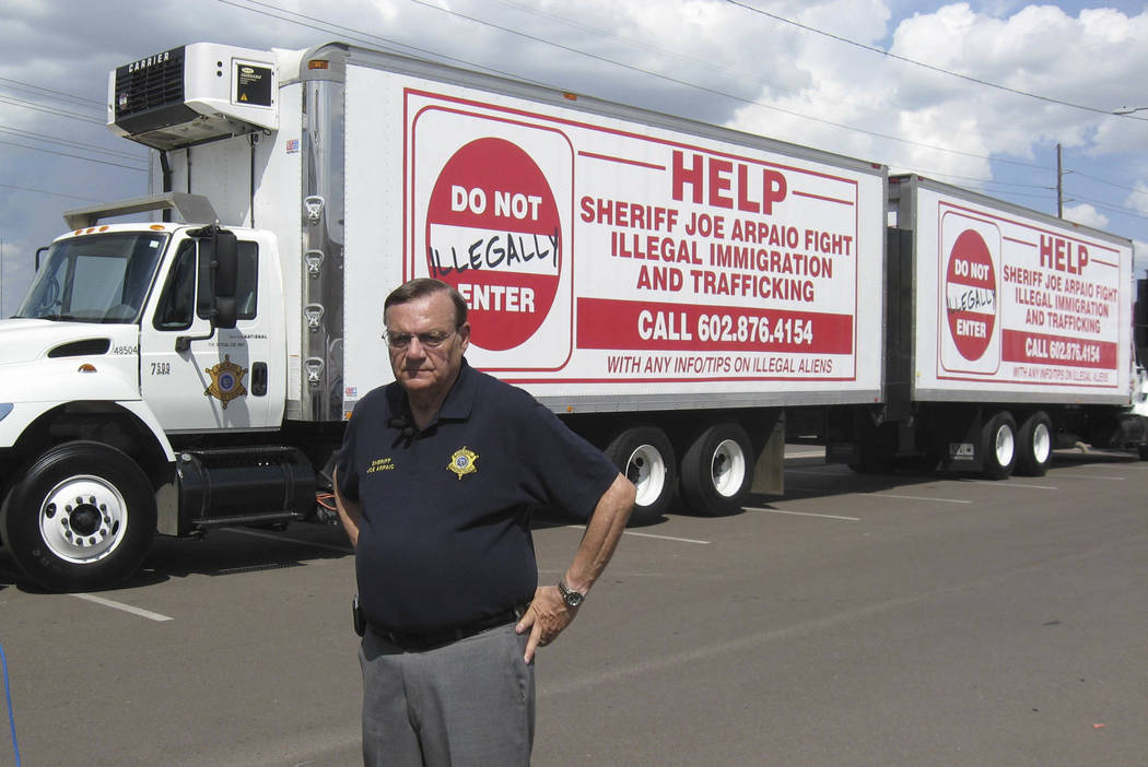 Maricopa County Sheriff Joe Arpaio shows off vehicles advertising a hotline to report undocumented immigrants in Phoenix, Arizona, Sept. 16, 2007. Arpaio has been convicted of a criminal charge Mo ...
