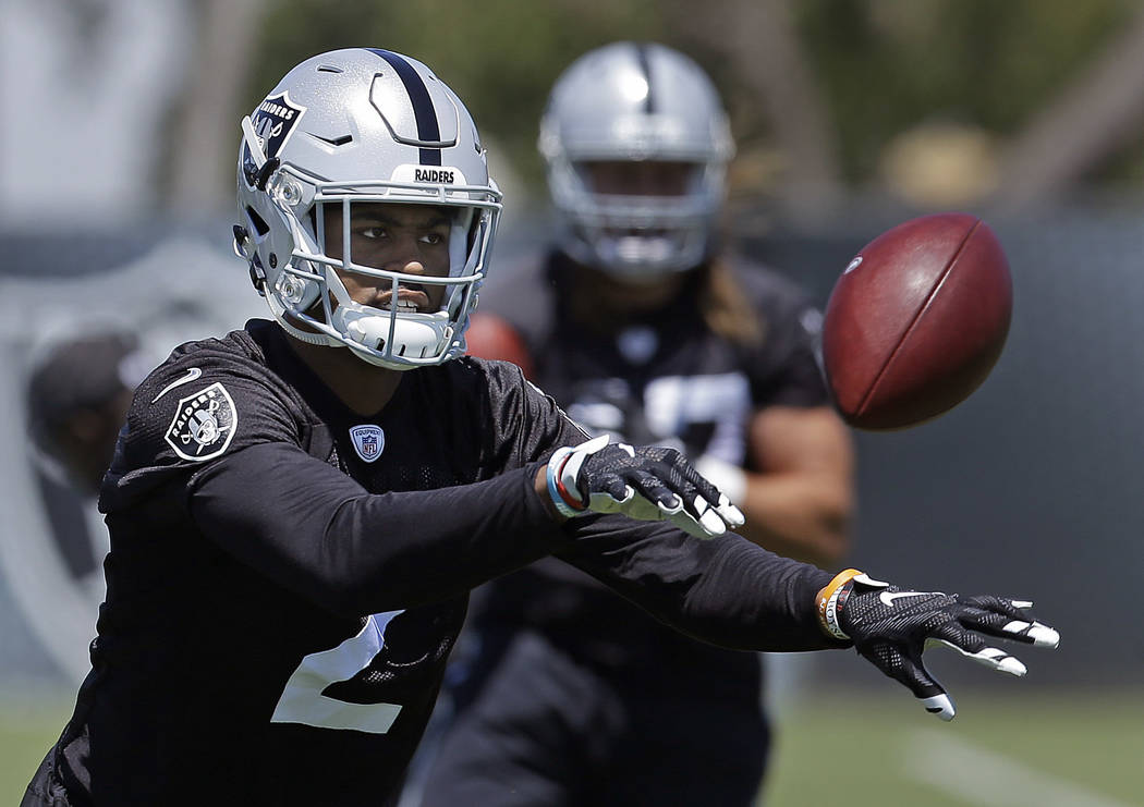 Oakland Raiders cornerback Gareon Conley tosses a ball during NFL football practice on Tuesday, June 13, 2017, at the team's training facility in Alameda, Calif. (Ben Margot/AP)