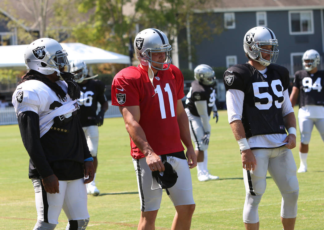 The Oakland Raiders running back Marshawn Lynch, left, kicker Sebastian Janikowski (11) and left safety Jon Condo (59) during teams practice at Raiders Napa Valley training complex in Napa, Calif. ...