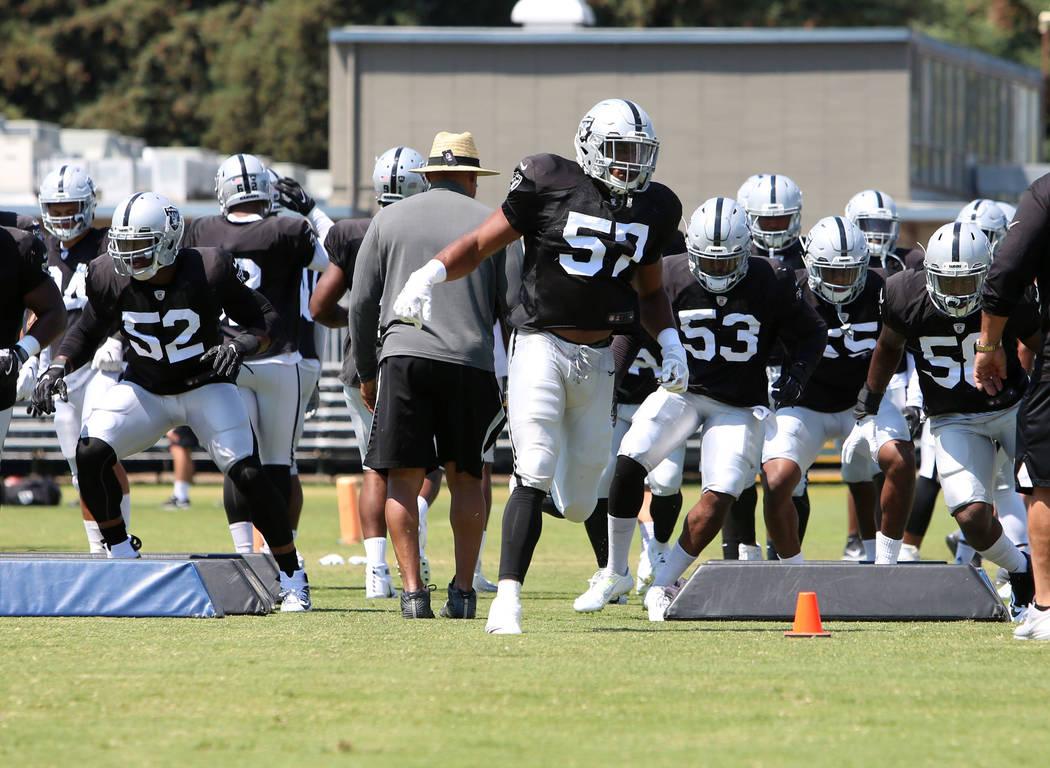 The Oakland Raiders defensive end Khali Mack (52)  linebackers Cory James (57) followed by Jelani Jenkins (53) run through obstacles during teams practice at Raiders Napa Valley training complex i ...