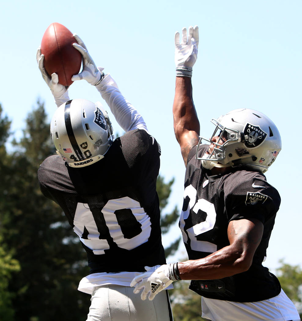 The Oakland Raiders cornerback Kenneth Durden (40) catches a pass over cornerback Antonio Hamilton (32) during teams practice at Raiders Napa Valley training complex in Napa, Calif., on Tuesday, A ...