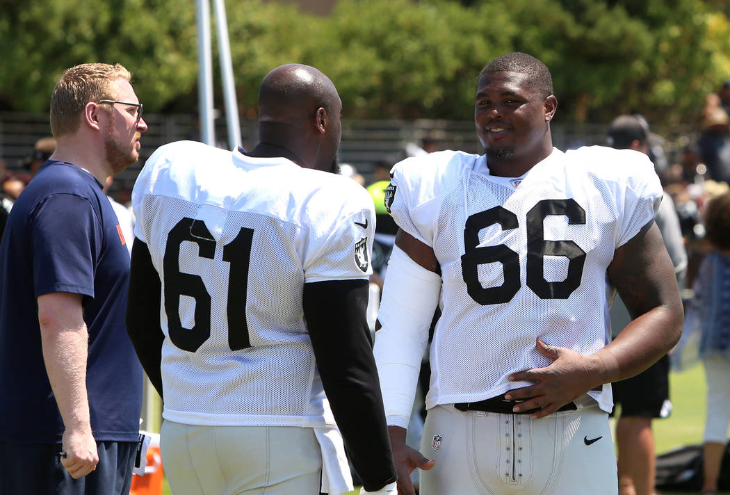 The Oakland Raiders center Rodney Hudson (61) and guard Gabs Jackson (66) chat after teams practice at Raiders Napa Valley training complex in Napa, Calif., on Tuesday, Aug. 1, 2017. Bizuayehu Tes ...