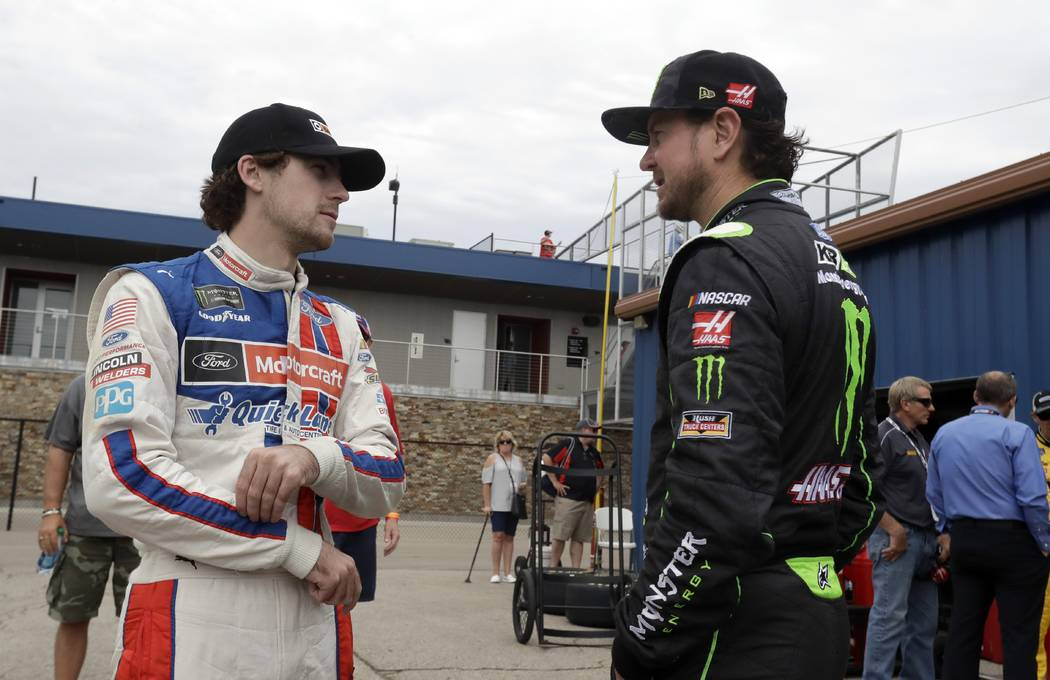 Ryan Blaney, left, talks with Kurt Busch before a practice session, Saturday, June 17, 2017, for the NASCAR Sprint Cup series auto race in Brooklyn, Mich. (AP Photo/Carlos Osorio)