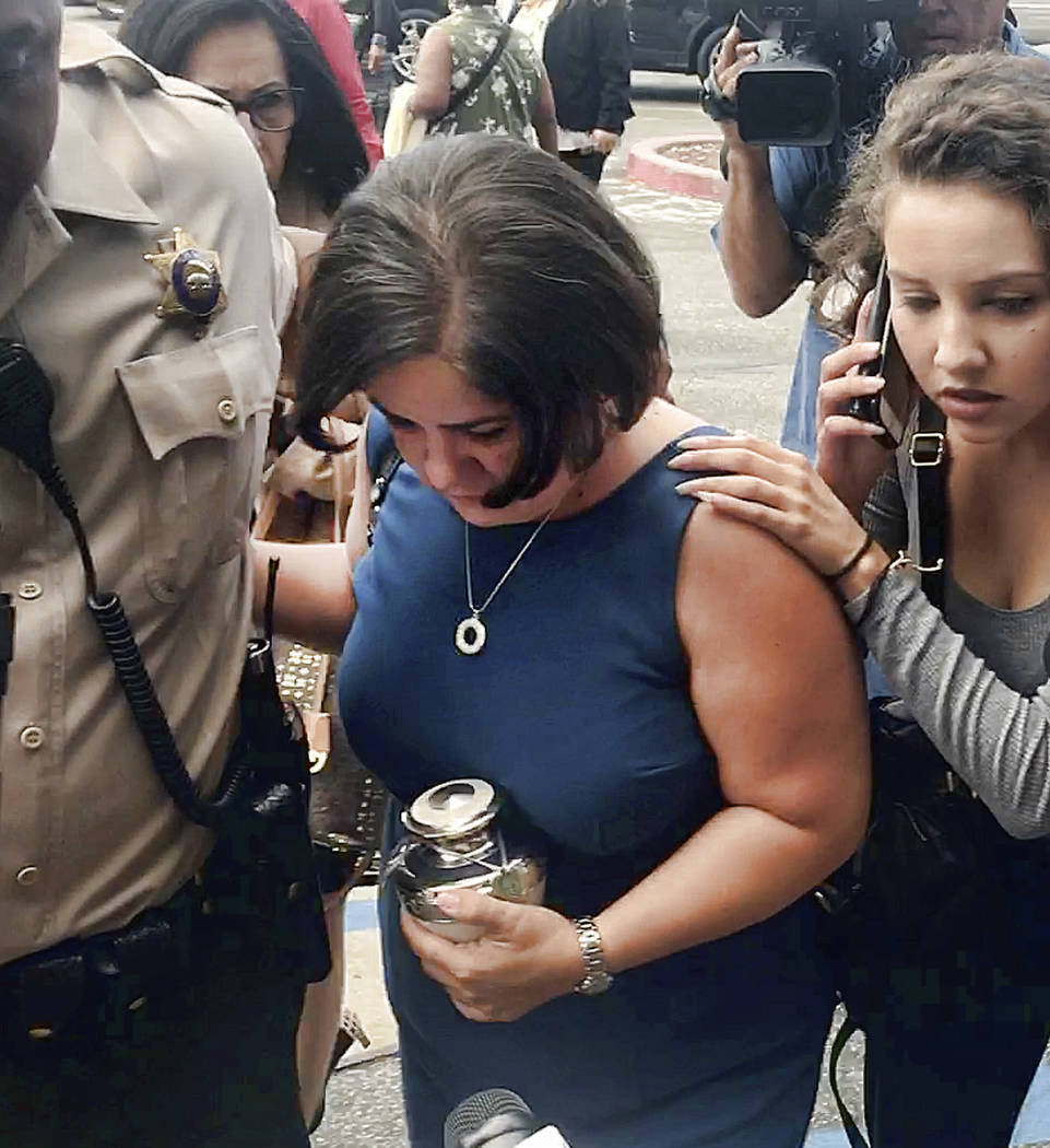 In this image taken from video, Ana Estevez, the mother of 5-year-old Aramazd Andressian Jr., carries an urn with her son's remains as she leaves a court hearing in Alhambra, Calif., Tuesday, Aug. ...