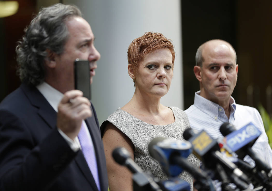 Dianne, center, and Seth Grossman, right, parents of Mallory Grossman, look as their attorney, Bruce Nagel, holds up a cell phone during a news conference in Roseland, N.J., Tuesday, Aug. 1, 2017. ...