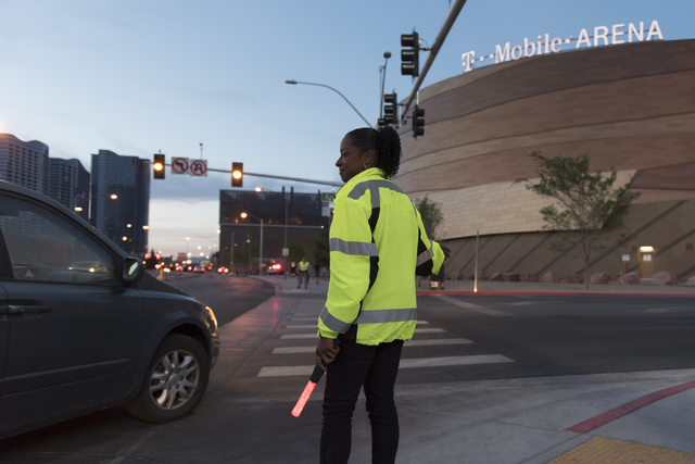 LaTia Goree of Las Vegas Traffic Control directs traffic to arena parking from Frank Sinatra Drive during T-Mobile Arena's opening day in Las Vegas Wednesday, April 6, 2016. The 20,000 seat arena' ...