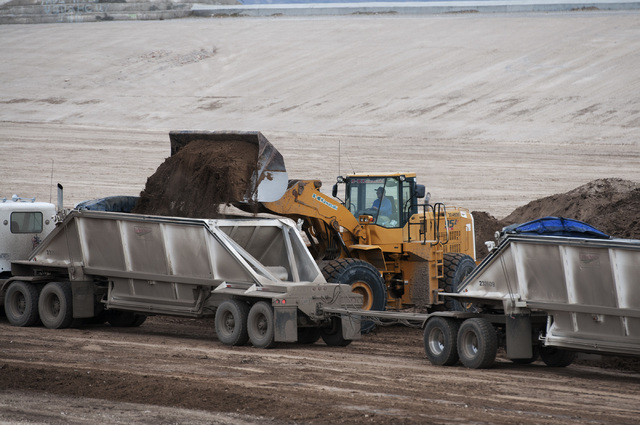 Crews remove debris accumulated in Kyle Canyon Detention Basin near Grand Teton Drive and Shaumber Road in Las Vegas Tuesday, Jan. 21, 2014. The debris came from floods after the Carpenter 1 fire  ...