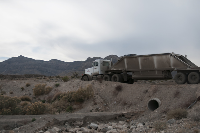 A truck arrives to remove debris accumulated in Kyle Canyon Detention Basin near Grand Teton Drive and Shaumber Road in Las Vegas Tuesday, Jan. 21, 2014. The debris came from floods after the Carp ...