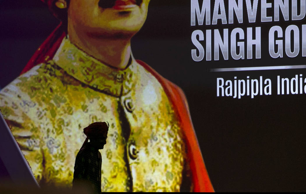 Openly gay Crown Prince Manvendra Singh Gohil of the state of Rajpipla in Gujarat, India is silhouetted against a display before speaking at a luncheon during the 15th annual NGLCC International B ...