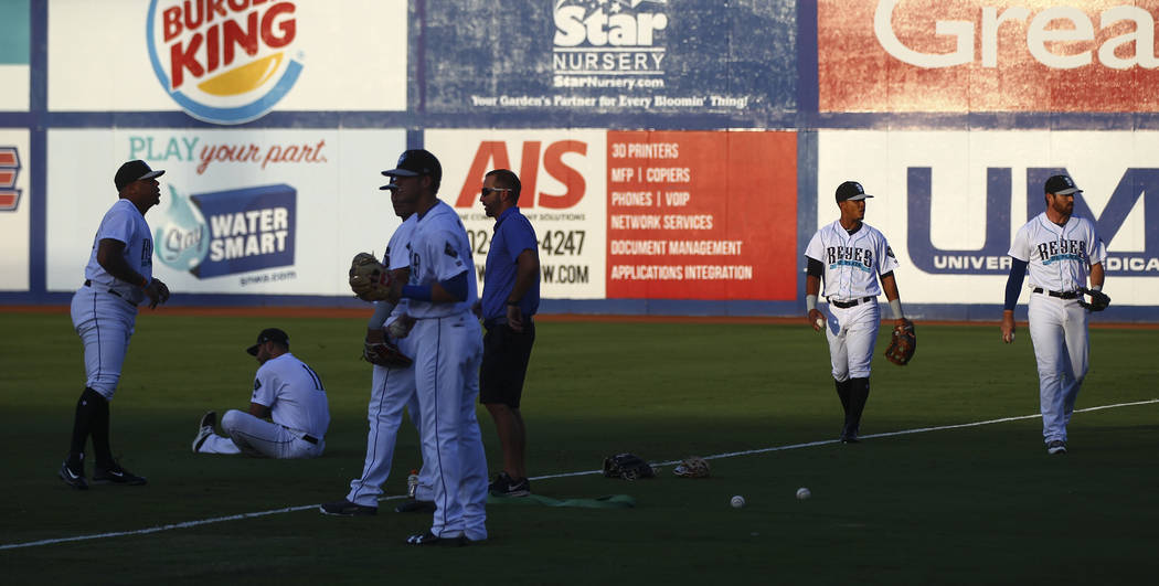 "Las Vegas 51s players warm up during the debut of the ""Reyes de Plata"" (Silver Kings), part of a new Minor League Baseball initiative, before playing the Colorado Springs Sky Sox ..."