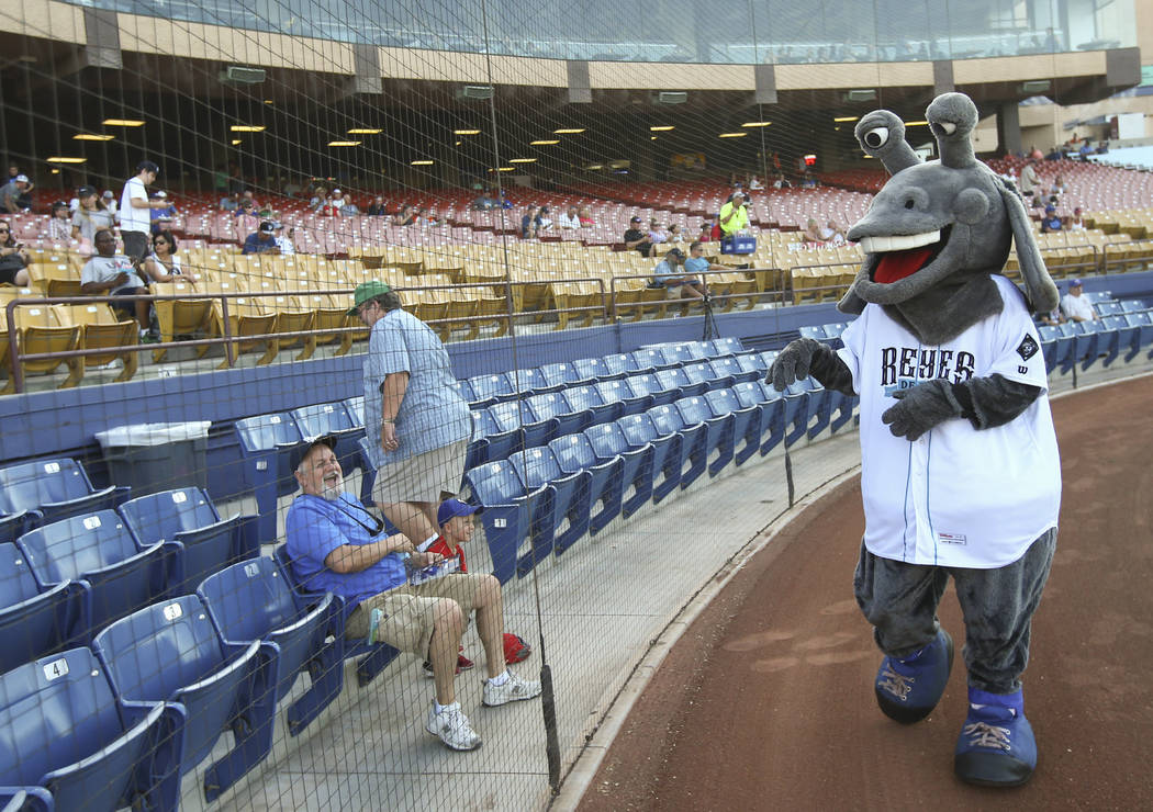 "Las Vegas 51s mascot Cosmo greets fans during the debut of the ""Reyes de Plata"" (Silver Kings), part of a new Minor League Baseball initiative, at Cashman Field in Las Vegas on T ..."