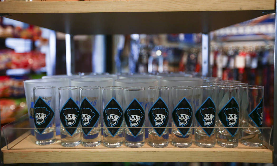 "Shot glasses featuring the special Las Vegas 51s ""Reyes de Plata"" (Silver Kings) name, part of a new Minor League Baseball initiative, are displayed at the team store at Cashman  ..."