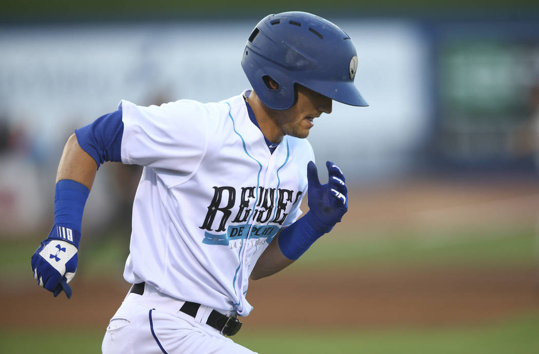 "Las Vegas 51s' Gavin Cecchini runs for first base during the debut of the ""Reyes de Plata"" (Silver Kings), part of a new Minor League Baseball initiative, while playing the Color ..."